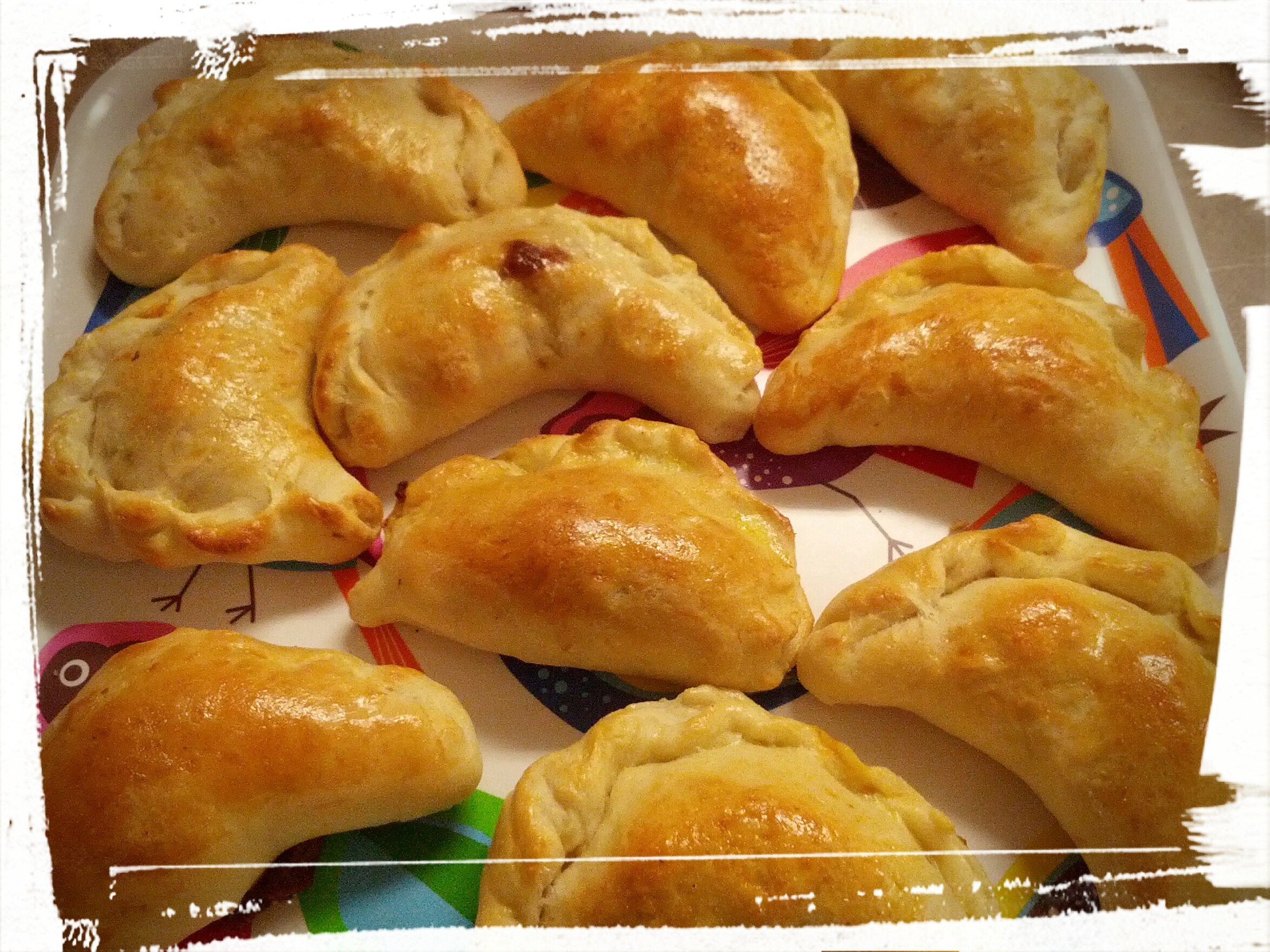 Golden-brown freshly baked empanadillas