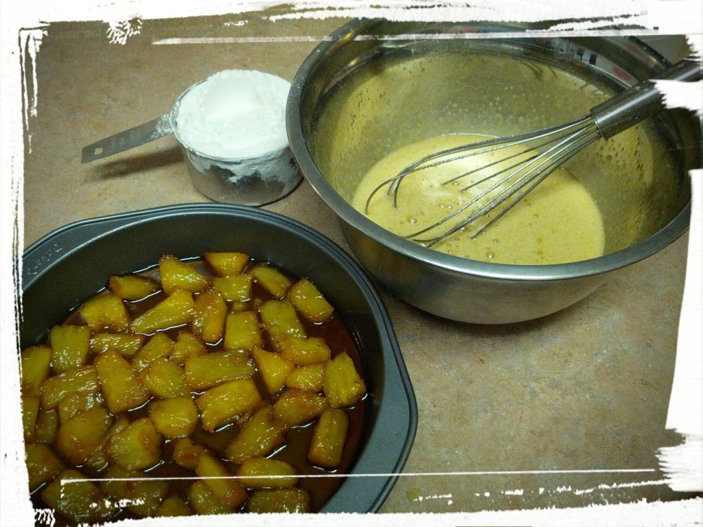 Mixing up the batter to pour over the caramelized fruit.