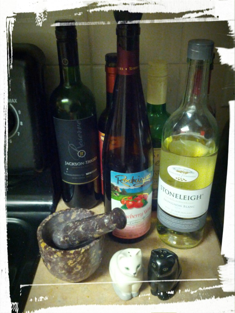 My cooking wine nook. Red wine, white wine, strawberry wine, cooking Sherry, and...red wine vinegar.