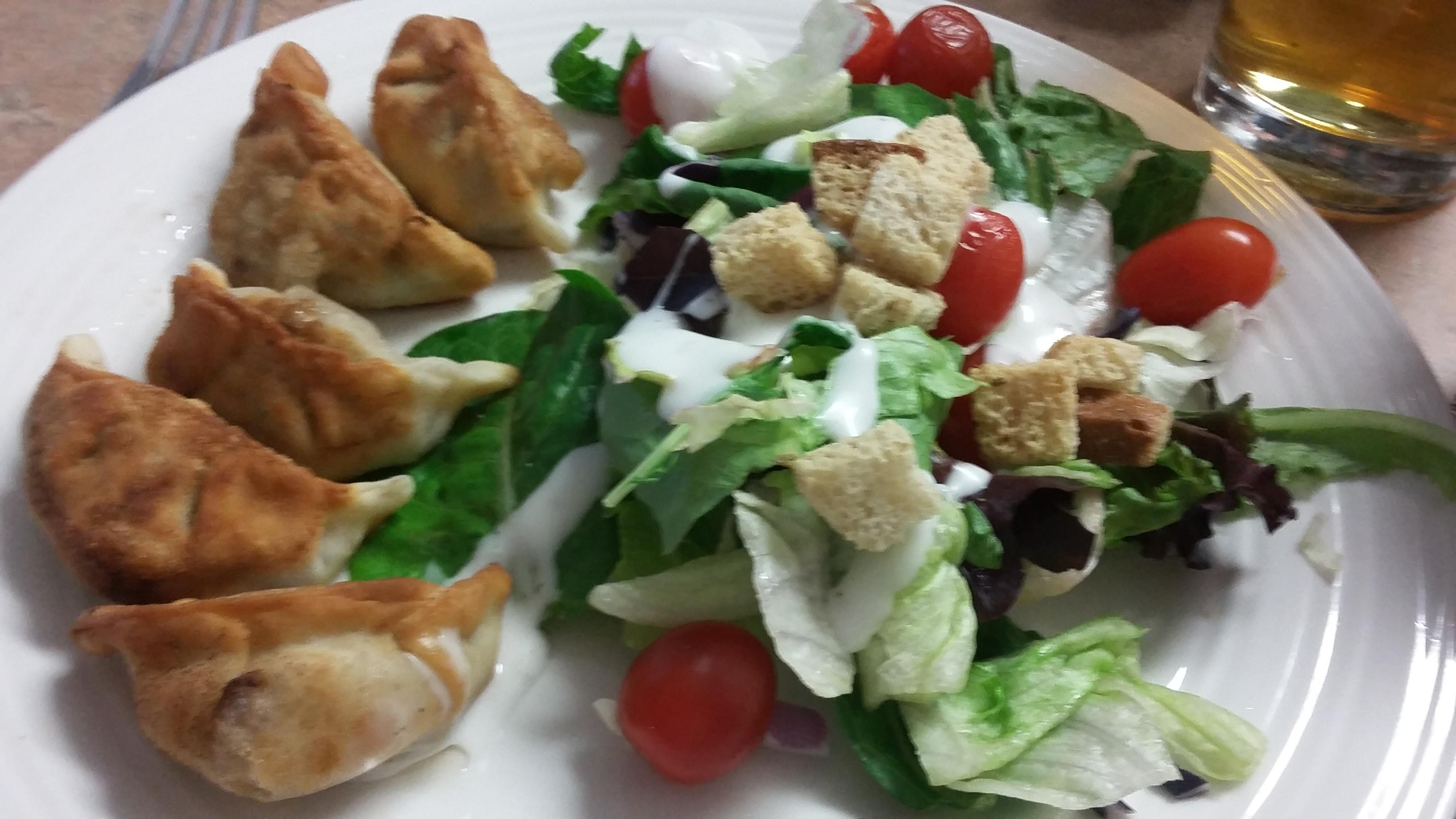 Panfried dumplings with a nice crisp green salad!