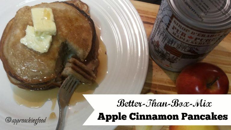Stack of apple cinnamon pancakes with butter and maple syrup.