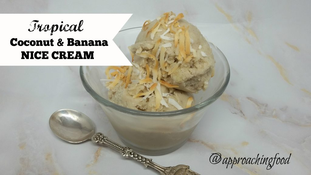 Scoops of nice cream in a bowl, topped with toasted coconut.
