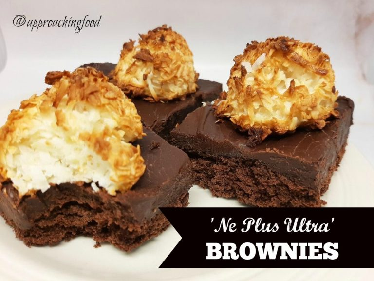 Brownies topped with fudge topped with a coconut macaroon.