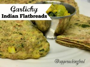 Flaky Indian flatbreads, served with dal for dipping.