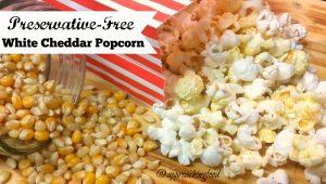 Preservative-free white cheddar popcorn spilling out of bag.