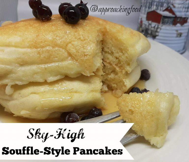 Sky High Souffle Style pancakes, served with berries and maple syrup.